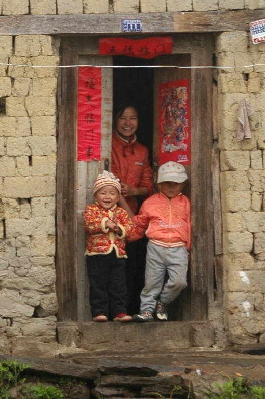 A young mother and her children, Yunnan, China